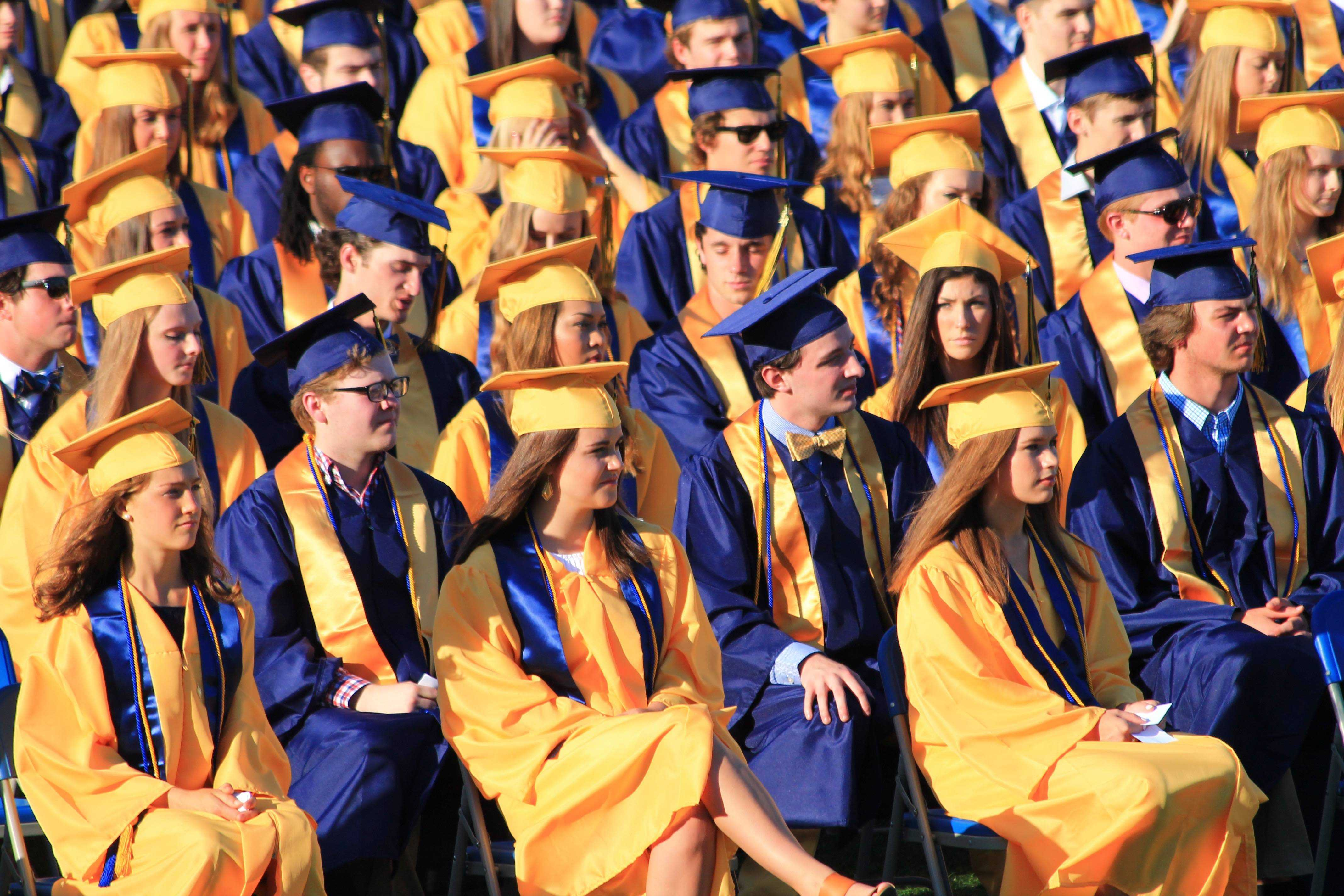 Class of 2016 lined up in rows as they listen to speeches