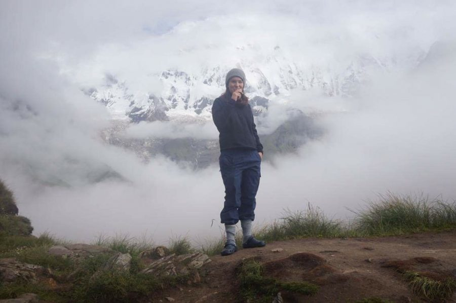 Jill+Woodhouse+%2717+stands+at+Annapurna+base+camp.+