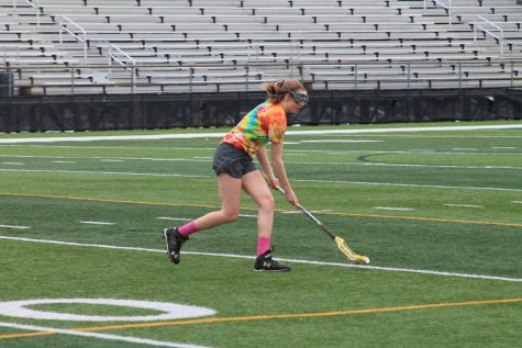 Maddie McCahill '17 runs after a ground ball at lacrosse practice.