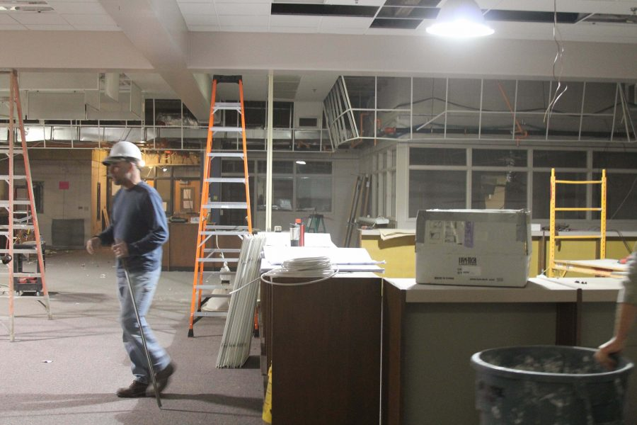 Construction workers begin the demolition phase of the renovation project in the East Grand Rapids High School Learning Commons. The construction workers have been rigorously working to meet their deadline. The Learning Commons has been currently relocated to the old Athletic Office.