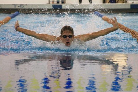 Cade Vruggink '17 competing in the 100 yard butterfly earlier this season at the home pool.