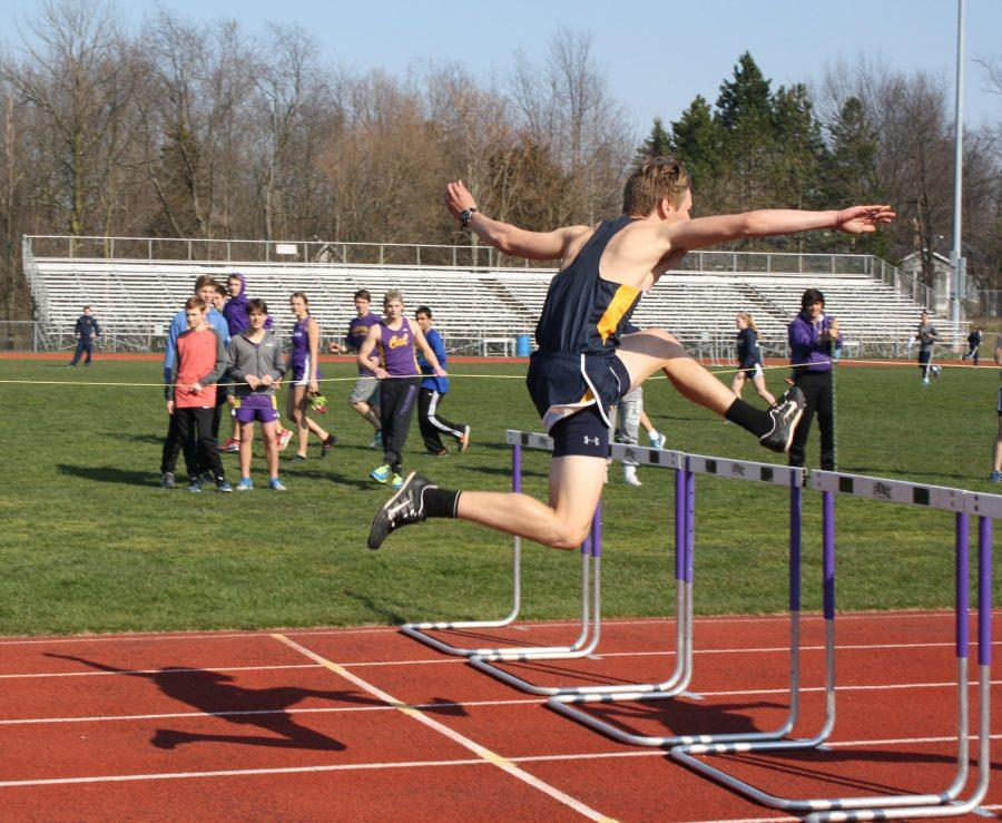 Reid Grunewald '16 swiftly jumps and earns himself third place in the 300 meter hurdle event.
