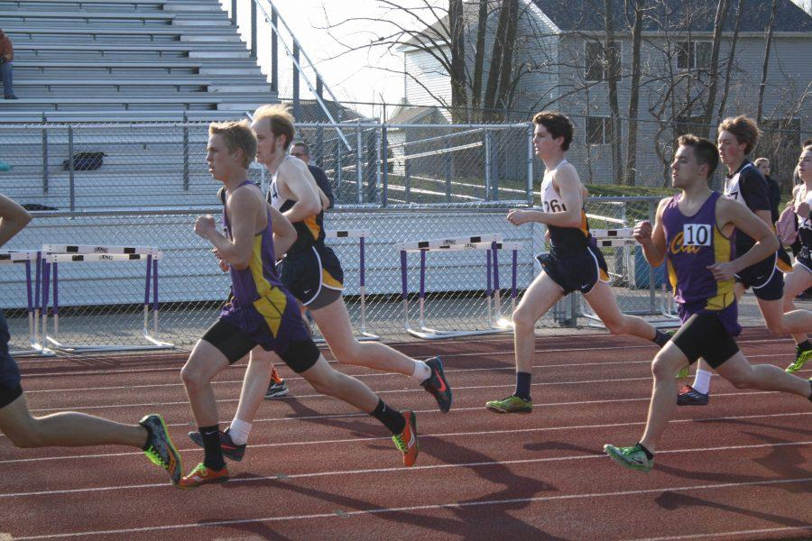 Ian Jenkins '17, Ben Oostendorp '17 and Robby McKay '16 pace themselves during the 1600 meter event.