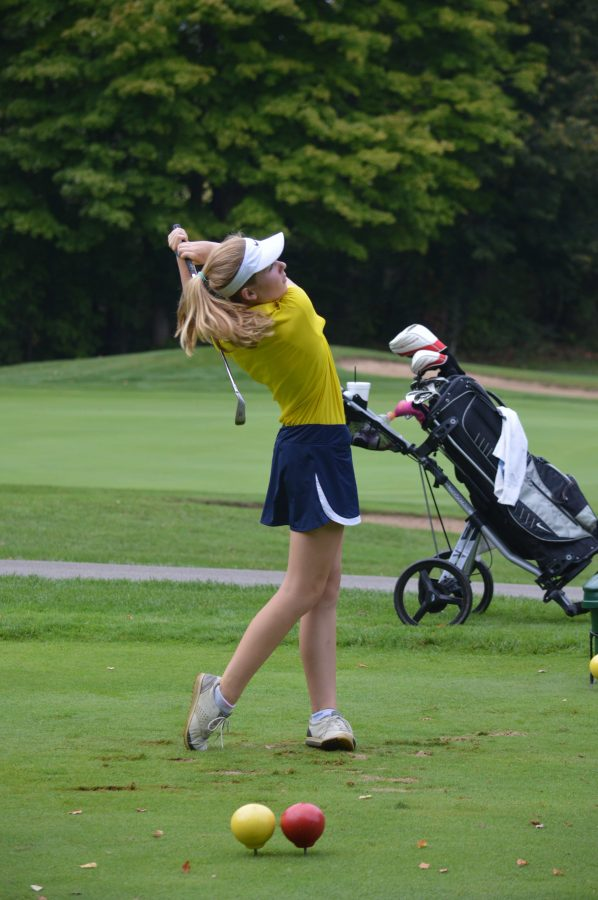 Claire Montague '18 practicing her swing at golf practice.