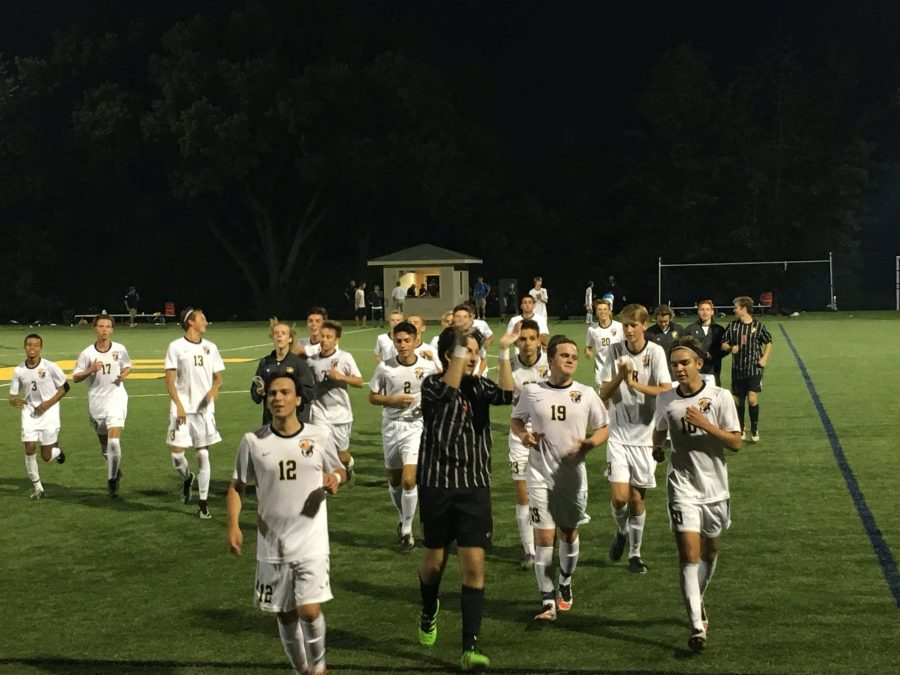 Boys soccer celebrates win against Grand Rapids South Christian on Tuesday night.