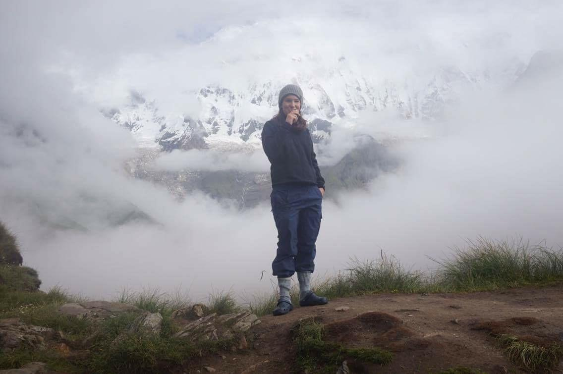 Jill Woodhouse '17 stands at Annapurna base camp.