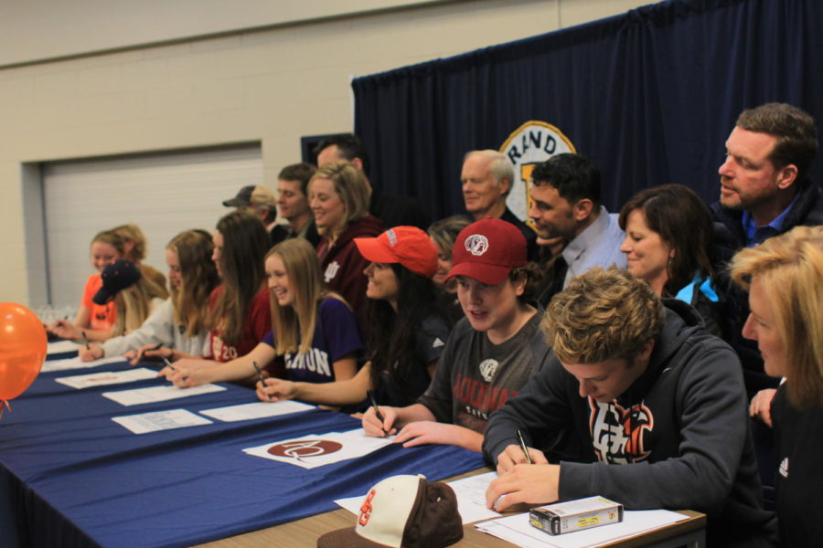 James Murray, Katie Persons, Mike Malewitz, Suzy Deems, Sara Vargo, Ileah Doctor, and Macy Alabitis '18 plan to continue their sports in college by signing to their respective colleges