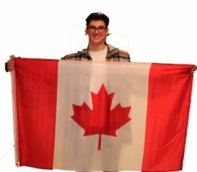 Elliot Jung 18 holds the Canadian flag to represent his dual citizenship. He is of several students who have two citizenships.