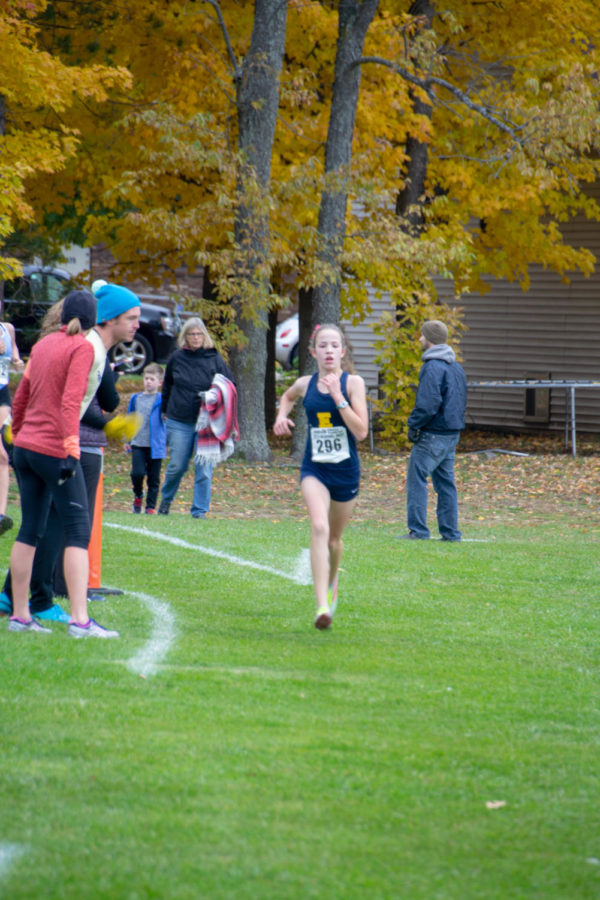 Katie Edison '22 runs at the Allendale Regionals race. She's a cross country athlete new to East.
