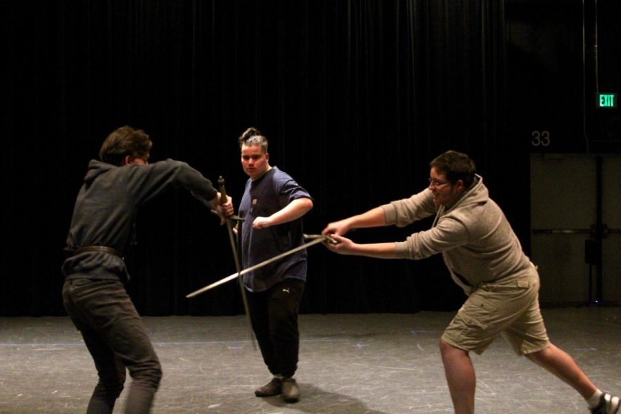 James Roberts '20 spars with Jordan Plumstead '20 and Luke Socie on the set of the fall play Macbeth.