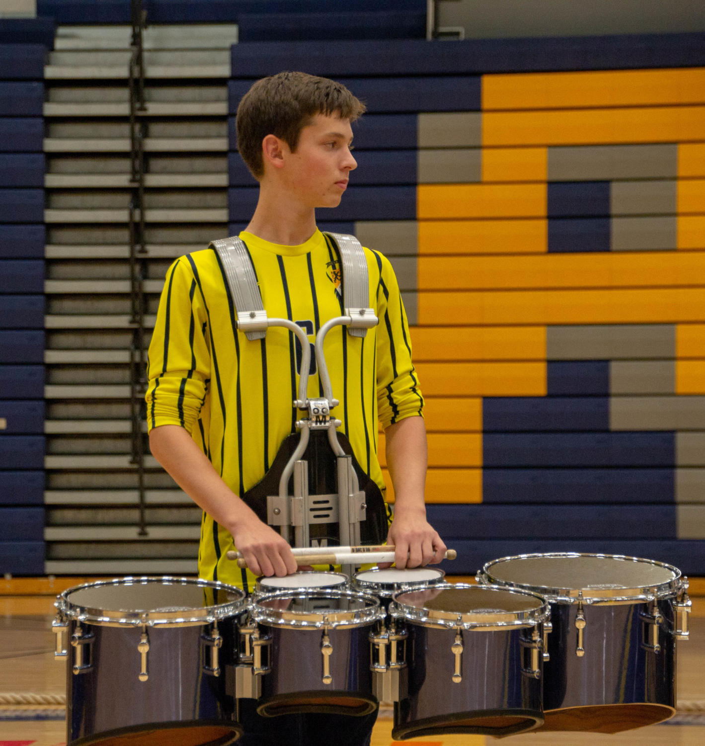 A+drumline+member+at+the+homecoming+assembly.