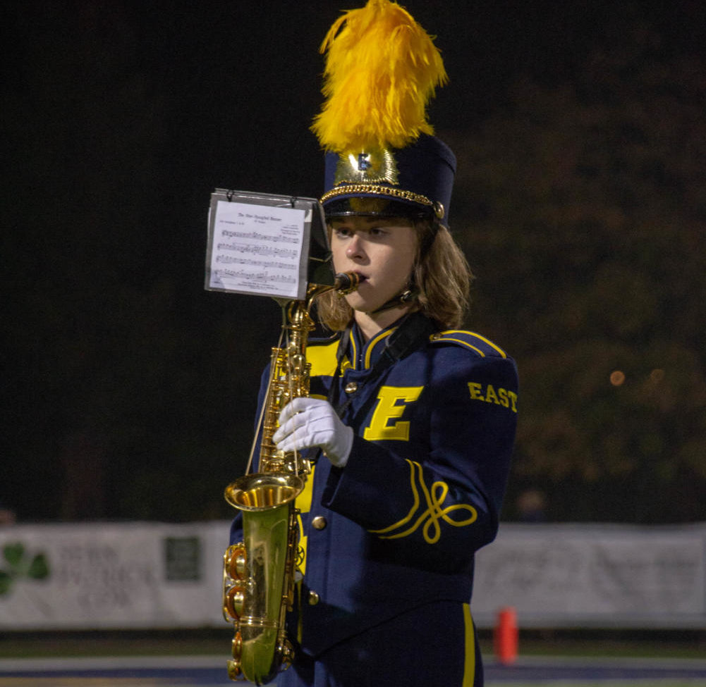 Maddy+Mayer+%2719+plays+her+saxophone+at+the+homecoming+game.