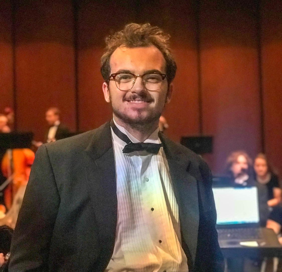 Orchestra director, Drew Johnston '19, poses for a picture following the Harmony for Humanity concert.
