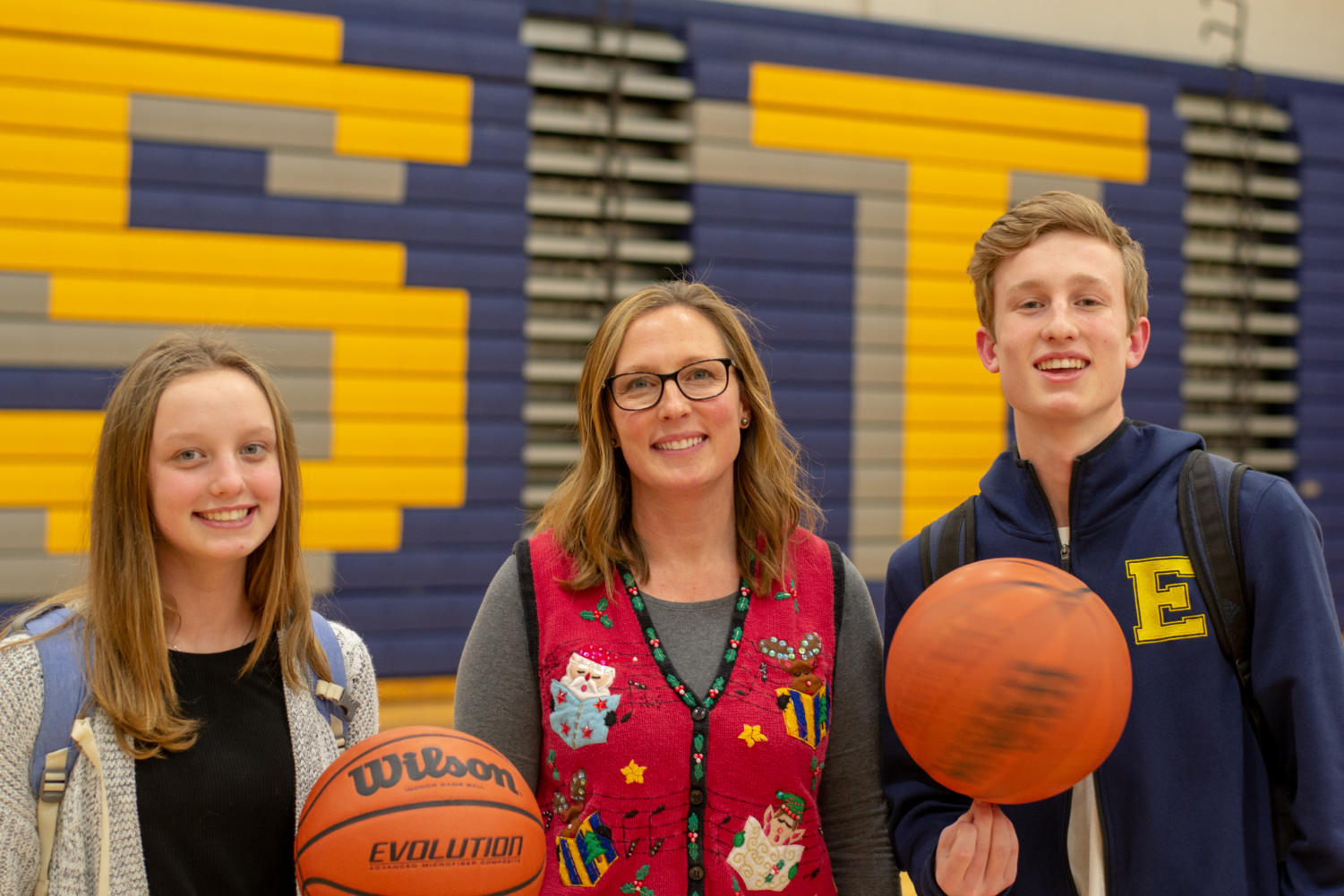 Chemistry teacher and coach Heather Carlson plays basketball with junior son Brendan and freshman daughter Alli.