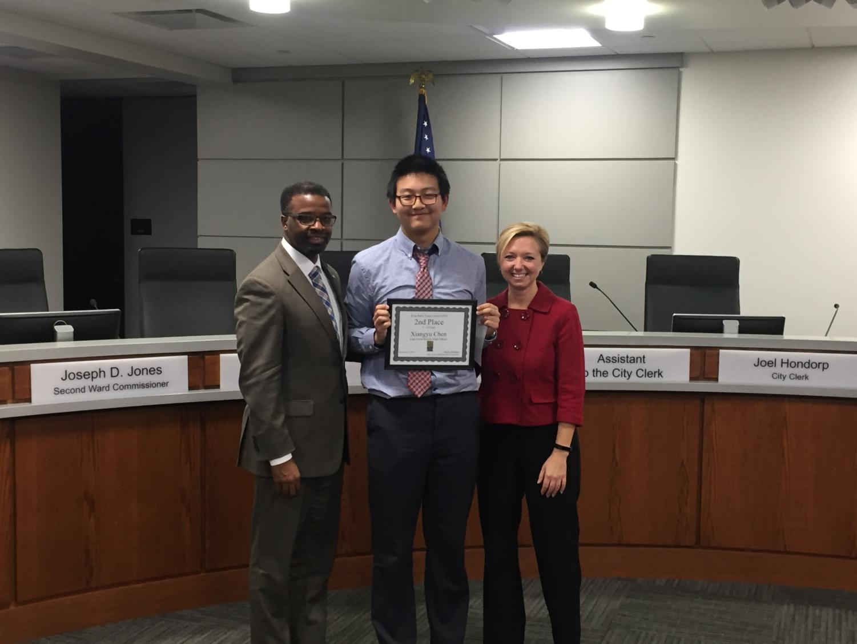 Chen '21 celebrates with City Manager Mark Washington and Mayor of Grand Rapids Rosalynn Bliss.