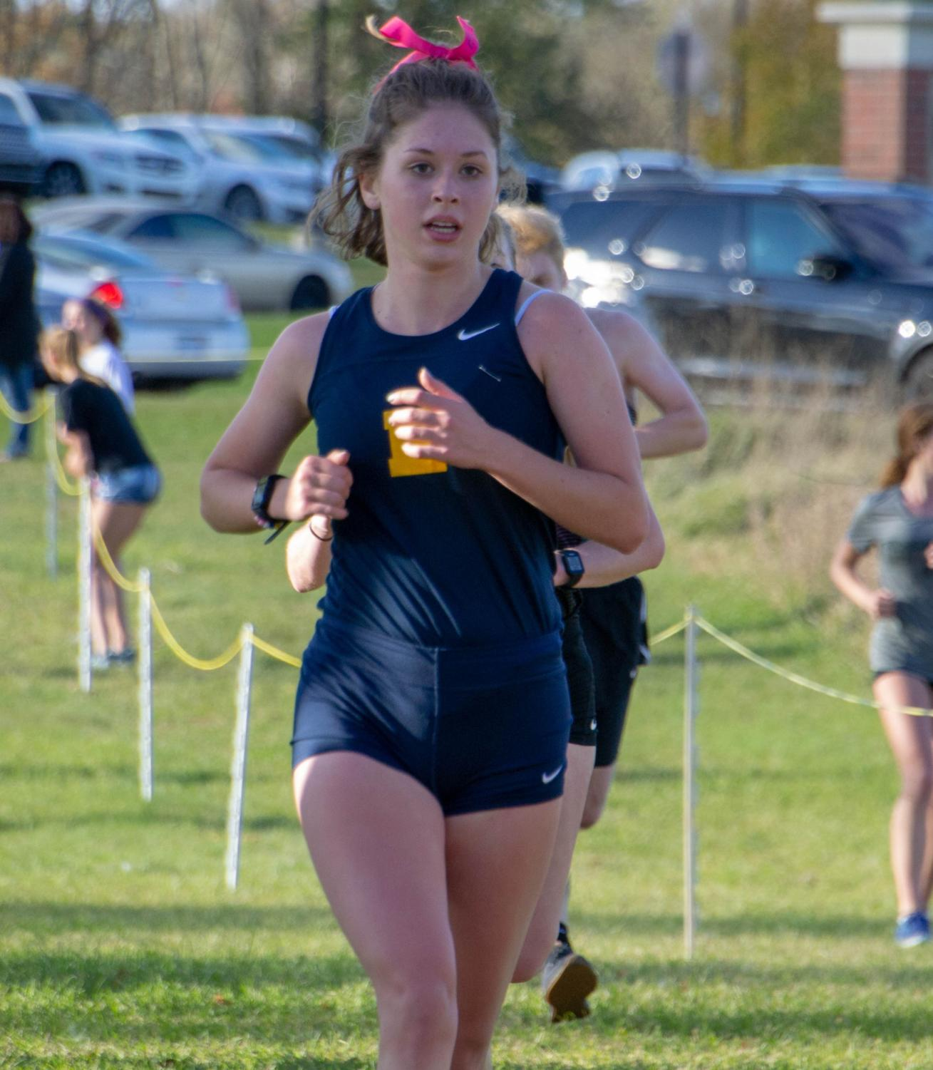Maddy+Mayor+%2719+runs+her+final+race+as+a+senior+at+Otsego+High+School+on+October+24%2C+2018.