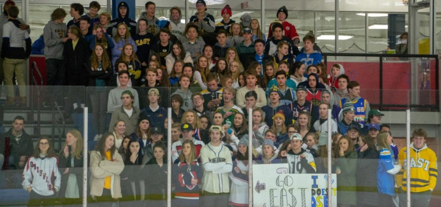 The East student section at the first hockey game of the season at Patterson Ice Center against Jenison high school.