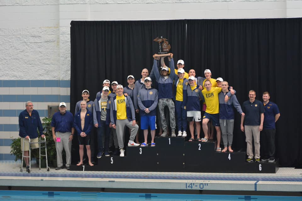 The Boys Swim team with their finalist runner-up trophy at the Division 3 state meet.