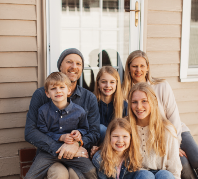The Stolle Family on their front porch