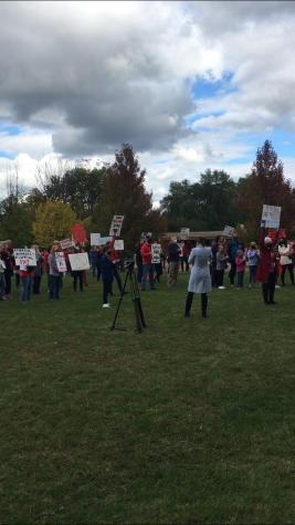 The community and educators picket at Woodcliff during contract negotiation