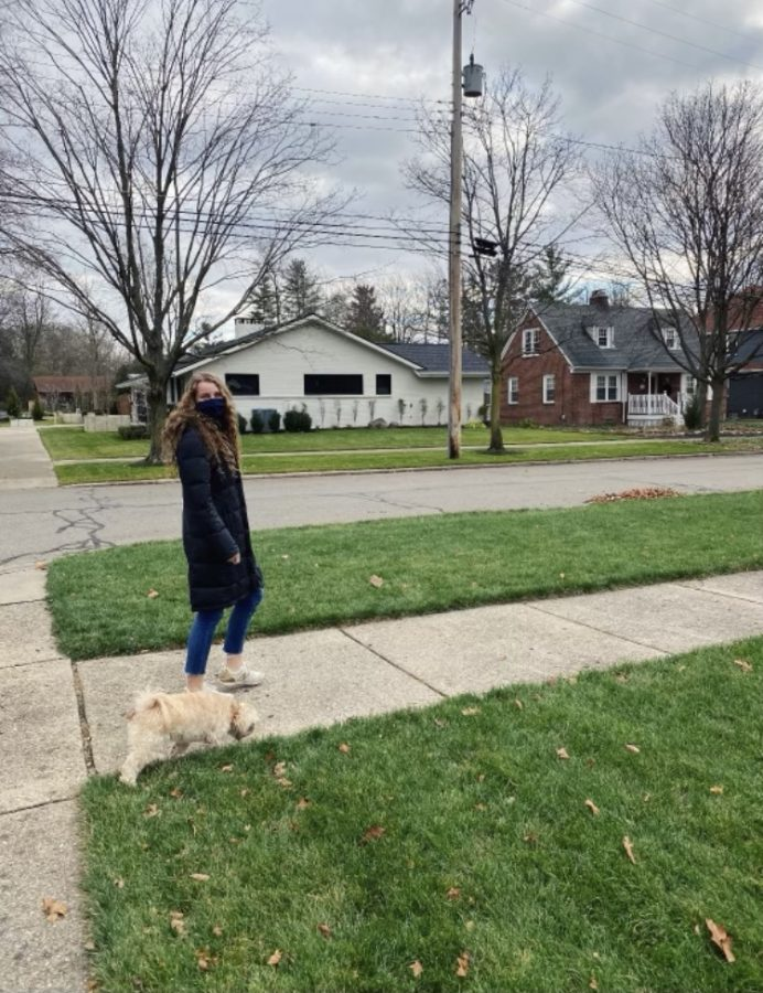 Bouwkamp taking a walk with her dog to escape home isolation for a little while.
