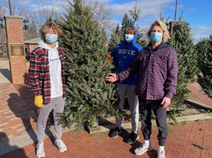 Glenn+Green+%E2%80%9924+%28Left%29+Alex+Collins+%E2%80%9924+%28Middle%29+Charlie+Hoekstra+%E2%80%9924+%28Right%29+selling+Christmas+trees+at+Gerken+Plaza