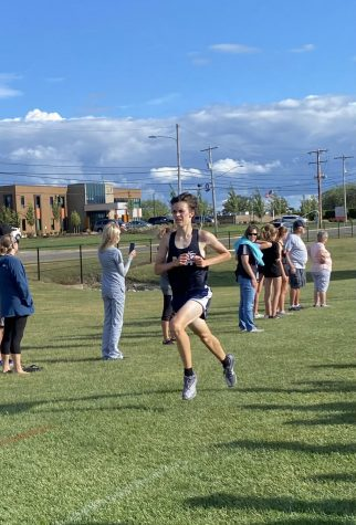 Eli Robinson 23 strains towards the finish line at Gainey Athletic Complex Wednesday.