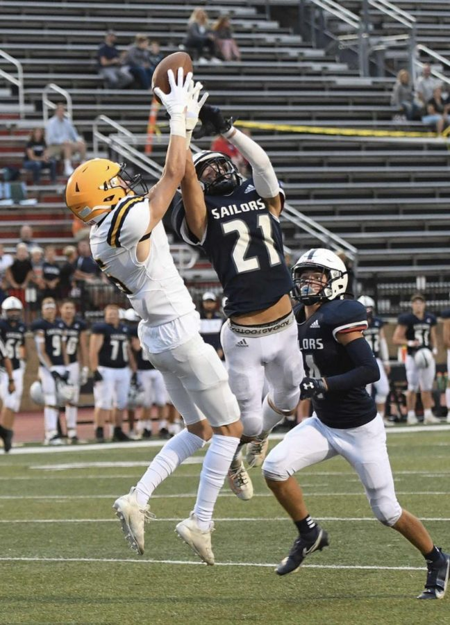Wide Receiver Ian Masek 22 reels in a crucial reception over a South Christian defensive back Friday.